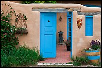 Adobe style walls, blue doors and windows, and courtyard. Taos, New Mexico, USA (color)