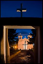 San Francisco de Asisis mission from entrance gate at night, Rancho de Taos. Taos, New Mexico, USA