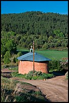Rural church with adobe walls and tin roof. New Mexico, USA (color)