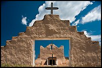 Adobe church framed by entrance in earthen wall, Picuris Pueblo. New Mexico, USA ( color)