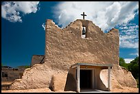 Facade of church covered with tightly compacted earth, clay, and straw, Picuris Pueblo. New Mexico, USA
