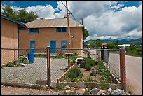 House with blue windows, Truchas. New Mexico, USA