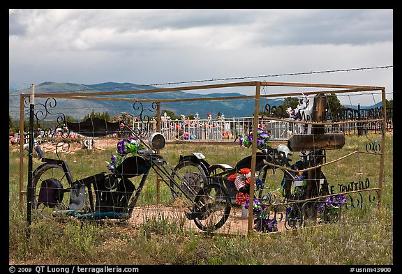 Grave with motorbikes, Truchas. New Mexico, USA (color)