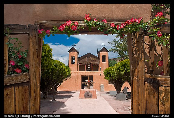 Church framed by doors with roses, Sanctuario de Chimayo. New Mexico, USA (color)