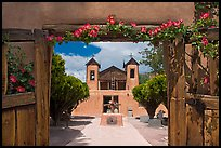 Church framed by doors with roses, Sanctuario de Chimayo. New Mexico, USA ( color)