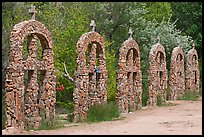 Brick and stone crosses by the river, Sanctuario de Chimayo. New Mexico, USA (color)