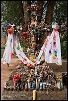 Cross festoned with popular devotion objects, Sanctuario de Chimayo. New Mexico, USA