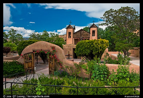 Gardens and walled courtyard, Sanctuario de Chimayo. New Mexico, USA (color)
