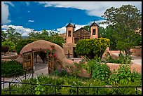 Gardens and walled courtyard, Sanctuario de Chimayo. New Mexico, USA