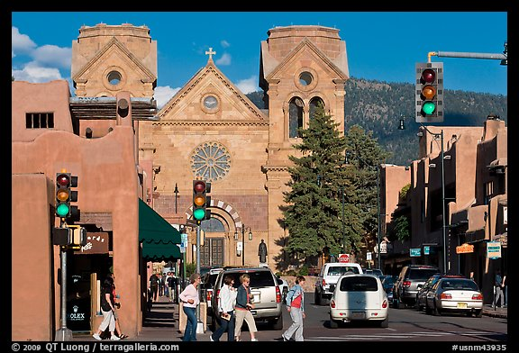 Pedestrians and street with cathedral, downtown. Santa Fe, New Mexico, USA