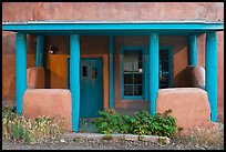 Blue and adobe house porch. Santa Fe, New Mexico, USA