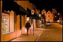 Man walking gallery and St Francis by night. Santa Fe, New Mexico, USA ( color)
