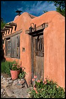 Flowers, adobe wall, and weathered door. Santa Fe, New Mexico, USA ( color)