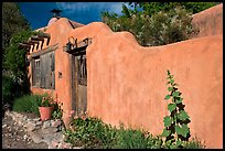 Adobe wall and weathered wooden door and window. Santa Fe, New Mexico, USA ( color)