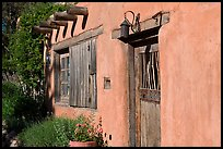 Door, window, and vigas (wooden beams). Santa Fe, New Mexico, USA