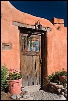 Wooden door and adobe wall. Santa Fe, New Mexico, USA (color)
