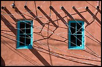 Detail of art installation on facade of adobe building. Santa Fe, New Mexico, USA