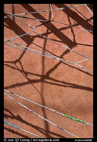 Shadows of vigas (wooden beams) and strings made of plastic bags. Santa Fe, New Mexico, USA (color)