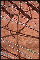 Shadows of vigas (wooden beams) and strings made of plastic bags. Santa Fe, New Mexico, USA ( color)