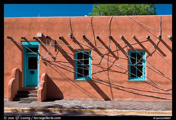 Adobe building tied up with plastic bags. Santa Fe, New Mexico, USA
