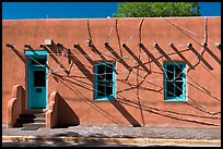 Adobe building tied up with plastic bags. Santa Fe, New Mexico, USA ( color)