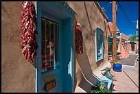 Ristras hanging in front of art gallery, Canyon Road. Santa Fe, New Mexico, USA (color)