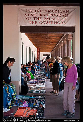 Tourists browse wares sold under native american vendors program of the palace of the governors. Santa Fe, New Mexico, USA (color)