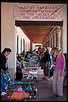 Visitors browse wares sold under native american vendors program of the palace of the governors. Santa Fe, New Mexico, USA (color)