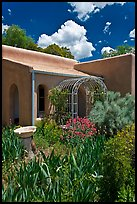 Garden and adobe house. Santa Fe, New Mexico, USA