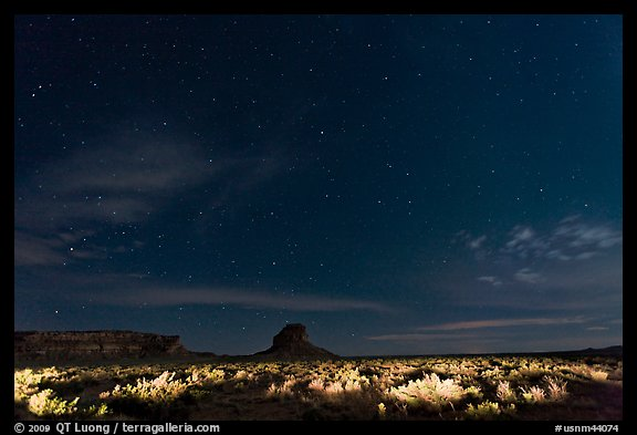 Night landscape with lighted canyon floor. Chaco Culture National Historic Park, New Mexico, USA (color)