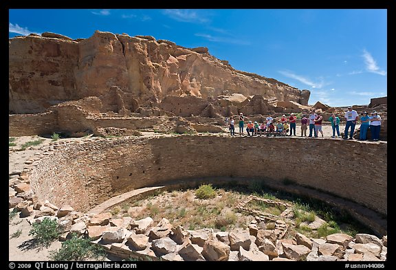 Tourists during a tour of Pueblo Bonito. Chaco Culture National Historic Park, New Mexico, USA (color)