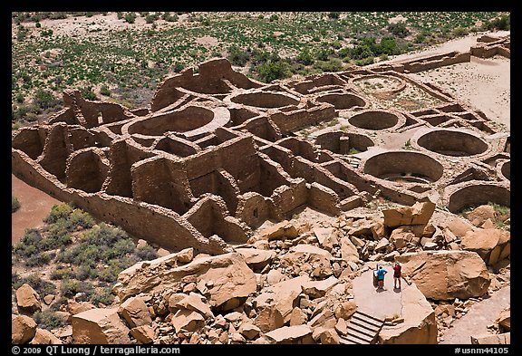 Visitors inspecting the complex room arrangement of Pueblo Bonito. Chaco Culture National Historic Park, New Mexico, USA