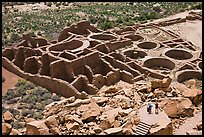 Visitors inspecting the complex room arrangement of Pueblo Bonito. Chaco Culture National Historic Park, New Mexico, USA (color)