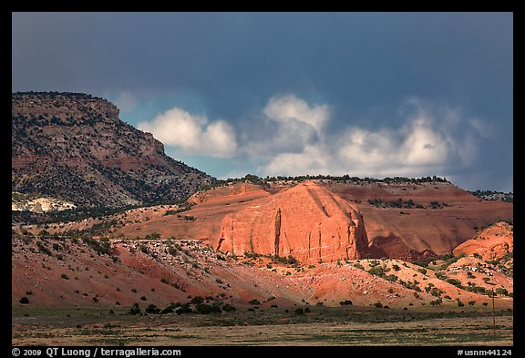 Red cliffs and dark sky. New Mexico, USA