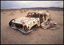 Car wreck used as a shooting target. Nevada, USA (color)