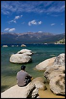 Man sitting on boulder, Sand Harbor, Lake Tahoe-Nevada State Park, Nevada. USA ( color)