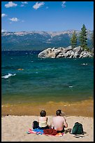 Couple on sandy beach, Lake Tahoe-Nevada State Park, Nevada. USA (color)