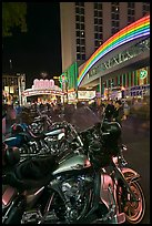 Harley-Davidson motorcycles on downtown street at night. Reno, Nevada, USA (color)