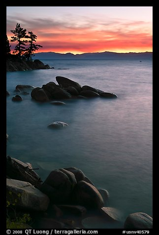 Sunset over lake with boulders, Sand Harbor, East Shore, Lake Tahoe, Nevada. USA (color)