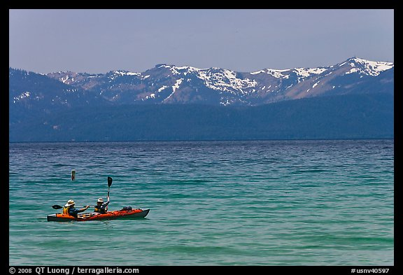 Kayak, turquoise waters and snowy mountains, East Shore, Lake Tahoe, Nevada. USA