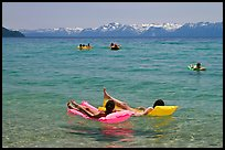 Children playing in water, and distant snowy mountains, Sand Harbor, Lake Tahoe, Nevada. USA ( color)