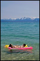Girls laying on floating mattress, Sand Harbor, East Shore, Lake Tahoe, Nevada. USA