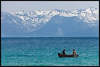 Canoe and snowy mountains, Lake Tahoe, Nevada. USA (color)