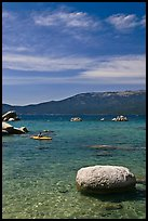 Boulders and kayak, Lake Tahoe-Nevada State Park, Nevada. USA (color)