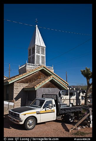 Truck and house with bell-tower, Beatty. Nevada, USA (color)