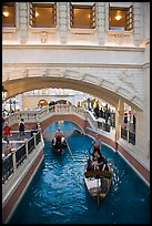 Couple kissing in gondola below bridge, Venetian casino. Las Vegas, Nevada, USA (color)