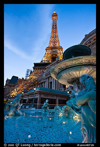 Fountain and Eiffel Tower replica at dusk, Paris casino. Las Vegas, Nevada, USA (color)