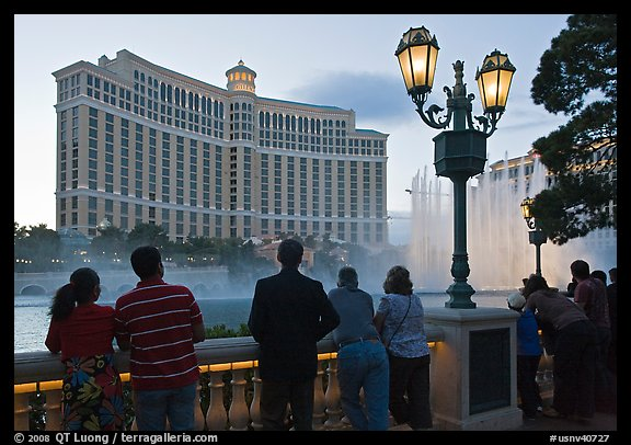 Watching the Fountains of Bellagio at dusk. Las Vegas, Nevada, USA (color)