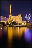 Paris Casino and Eiffel Tower reflected at night. Las Vegas, Nevada, USA