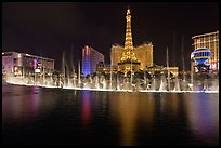 Bellagio dancing fountains and casinos reflected in lake. Las Vegas, Nevada, USA (color)